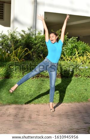 A Young  Minority Female Dancing