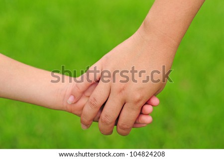 A young mother and child holding hands