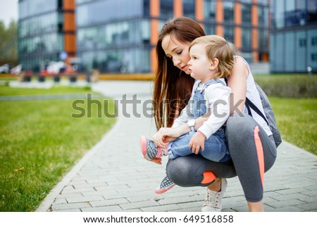 A young mother with her daughter on a walk. #649516858