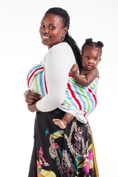 A young mother with 8 month old baby being photographed in the studio.