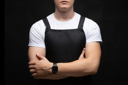 A young, muscular guy in an apron folded his arms over his chest.