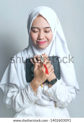 Young muslim woman holding a book Images and Stock Photos