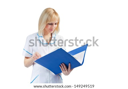 A young nurse looking at medical records of patients of the clinic, isolated on white background