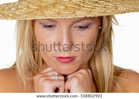 a young, pensive woman in a straw hat. portrait on a white background