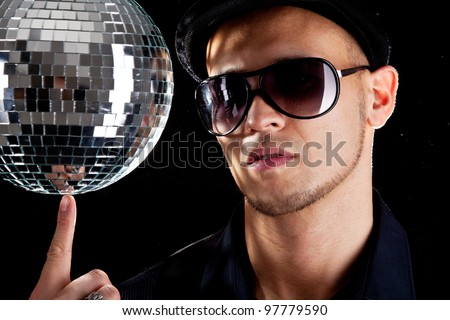 A young philippino playing with a disco ball