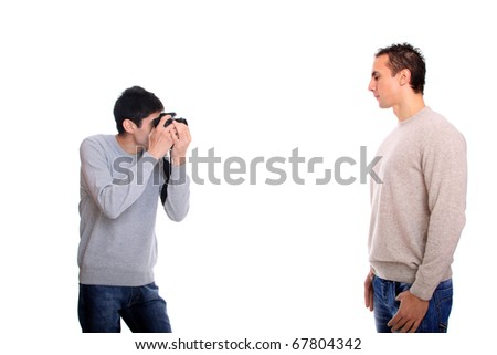 A young photographer taking a photo of a model with DSLR camera