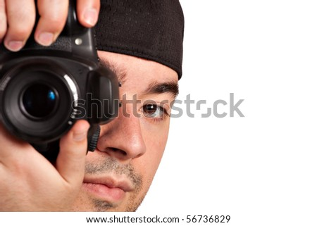 A young photographer taking a photo with his digital single lens reflex camera