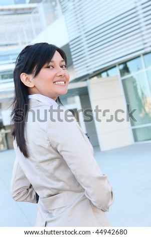 A young pretty asian business woman at office building