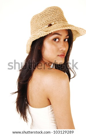 A young pretty Asian woman wearing a beige straw hat and a shoulder  free top, with long brunette hair, for white background.