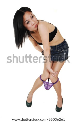 A young pretty Asian woman with a bra and mini skirt loosing her lilac lace panties and is very upset, over white background.