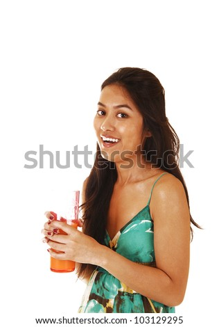 A young pretty Asian woman with a glass of juice in her hand laughing into the camera for white background.