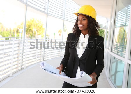 A young pretty woman working as architect on a construction site