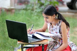 A young rural Indian girl is studying online.Study in lock down. Online school classes. Schools closed due to Covid-19. Role of technology during nationwide lock down.Learning at home.