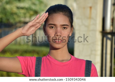A  Young Saluting Filipina Female