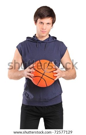 A young school boy holding a basketball isolated on white background