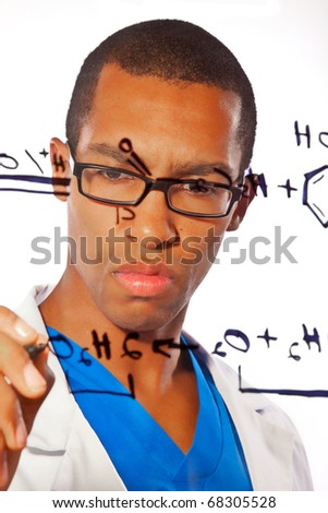 A young scientist works on a chemistry equation