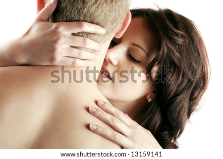 a young sexy couple is kissing isolated on white background