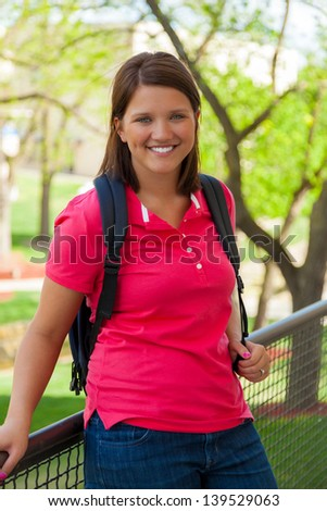 A Young, smiling college student outside
