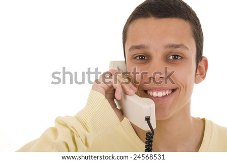 A young smiling man on phone