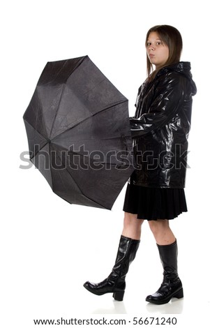 A young teen girl in rain gear, wondering if she can take her umbrella down.  Isolated on white.