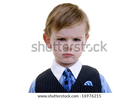 A young toddler boy mad about something