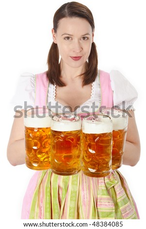 A young waitress serving many beers Oktoberfest style