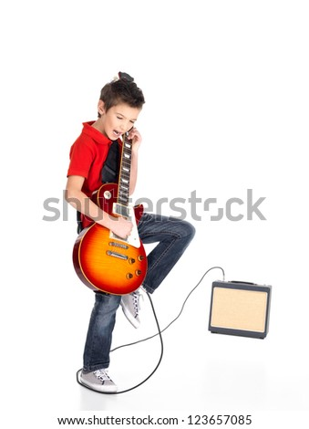 A young white boy sings and plays on the electric guitar with bright emotions, isolated on white background