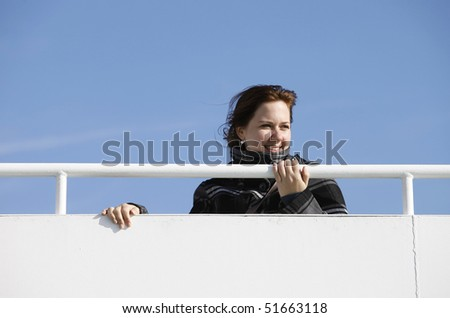 A young woman at a guardrail during a ship transfer