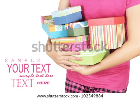a young woman carrying a lot of gifts, isolated on white background