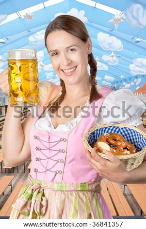 A young woman celebrating in an Oktoberfest tent setting with a mass of beer.