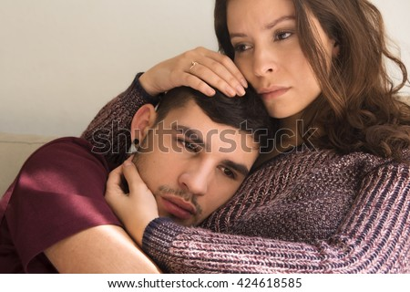 A young woman comforts her significant other; men do not have to be the strong ones.