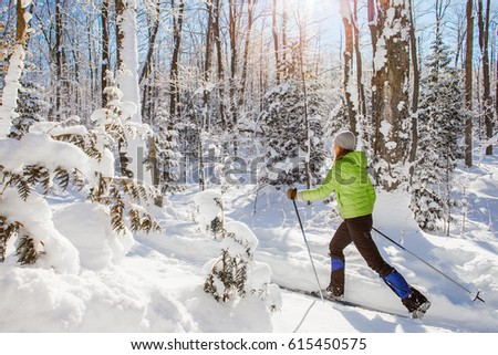 A young woman cross country skiing in Ontario, Canada. #615450575