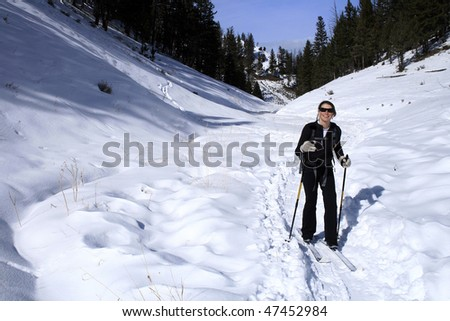 A young woman cross country skiing in Yellowstone National Park