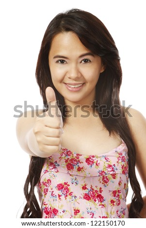 A young woman doing a thumbs up sign (isolated on white)
