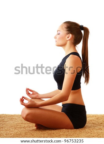 A young woman doing yoga, isolated on white background