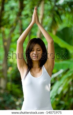 A young woman doing yoga outside
