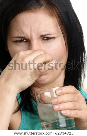 a young woman drinks some vodka with ice