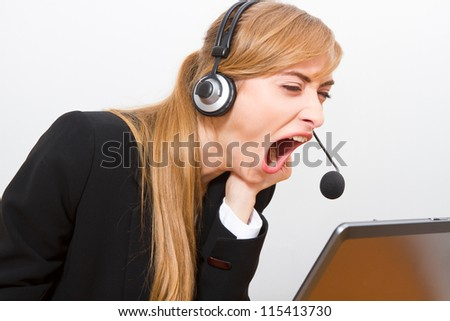A young woman expresses emotions at work.