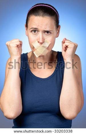 A young woman frustrated at being silenced.
