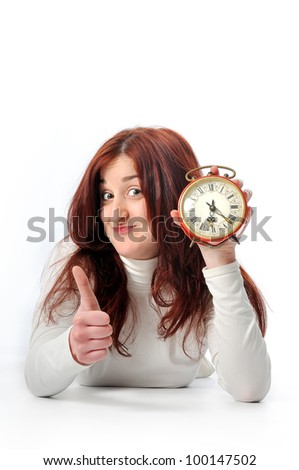 a young Woman hold a clock