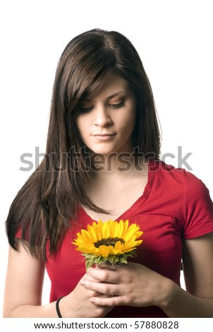 A young woman holding a sunflower.