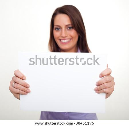 A young woman, holding an empty paper in her hands