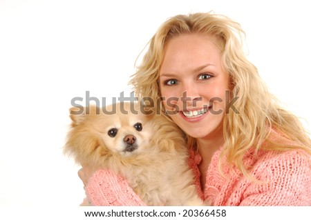A young woman holding her pomeranian.