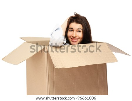 A young woman in a box , isolated on white background