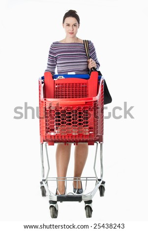 A young woman in a domestic role pushing an empty shopping cart.