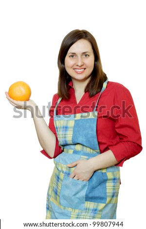 A young woman in an apron with a grapefruit in her hands. White background.