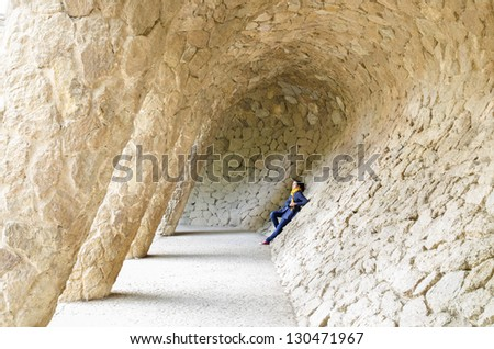 A young woman in Guell park in Barcelona