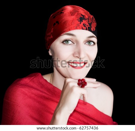 A young woman in the red on a black background. Isolated.