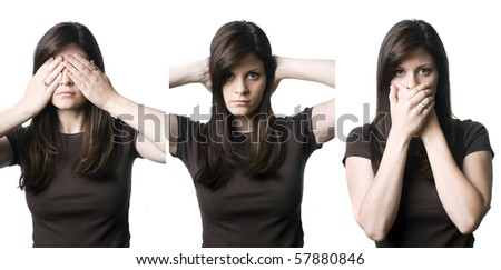 "A young woman indicating the popular phrase, ""See no evil, hear no evil, speak no evil"". - stock photo"