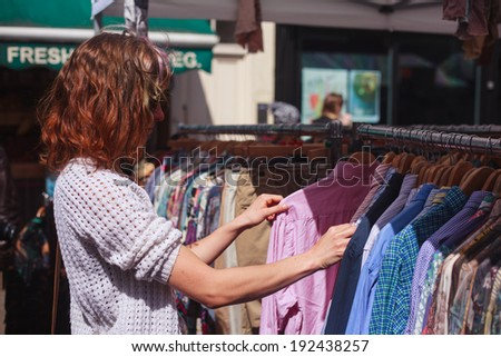 a young woman is browsing a...